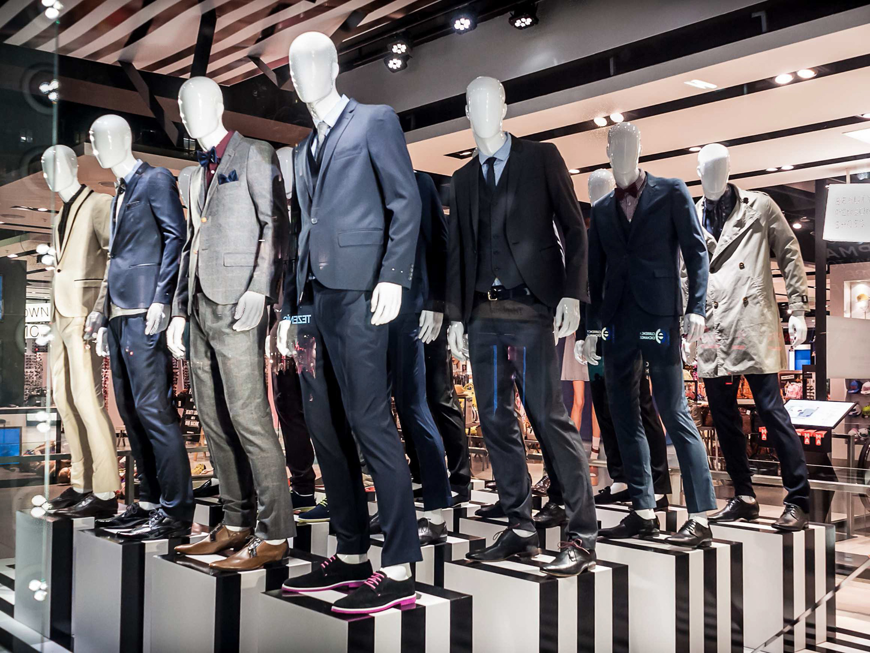 many male mannequins in a store